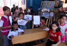 Niños refugiados en una escuela administrada por la ONU en Shujaiyeh, un vecindario de Gaza. Crédito: Khaled Alashqar/IPS